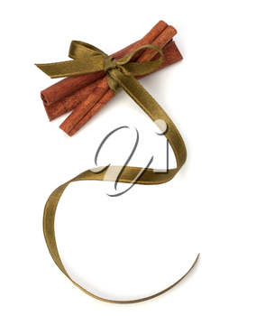 Festive wrapped cinnamon sticks isolated on white background