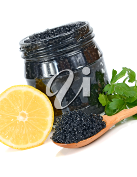 caviar black in a glass jar with lemon and parsley isolated on white background
