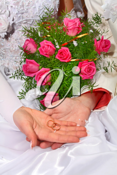 two wedding rings and bouquet for fiance and fiancee