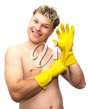 man in yellow rubber gloves on white background