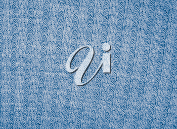 blue knitted fabric as a background. macro