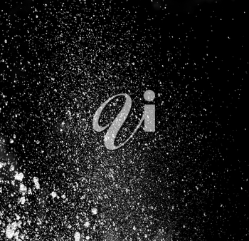 Abstract background. Splash of water in the form of rain on a black background