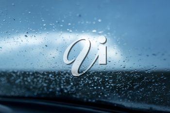 raindrops on a windshield of car