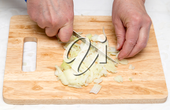 Cook chopped onion on the board