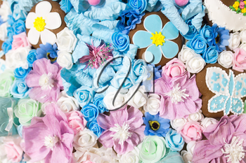 Beautiful artificial blue flowers as a background. texture
