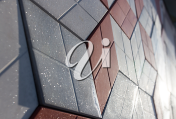 a wall of decorative tiles as background