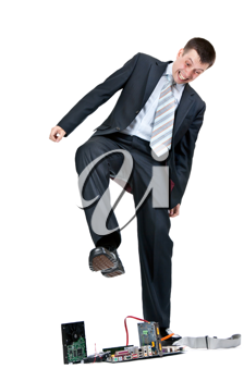 Royalty Free Photo of a Businessman Trampling on a Computer