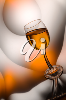 Glass of cognac in a distorted reflection.