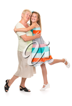 Grandmother with her granddaughter in the studio on a white isolate