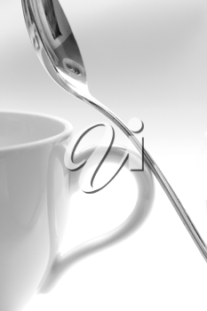 Royalty Free Photo of a Teacup and Spoon