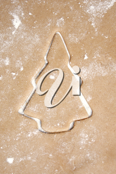 Royalty Free Photo of a Cookie Cutter on Dough