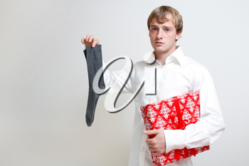 Royalty Free Photo of a Man Holding a Present and a Sock