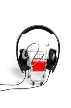 Royalty Free Photo of a Miniature Cart and Headphones