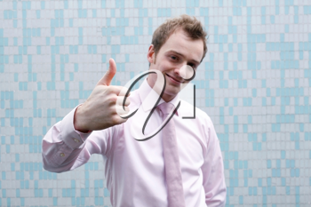 Royalty Free Photo of a Businessman Giving a Thumbs Up