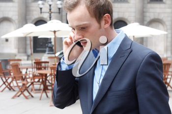 Royalty Free Photo of a Businessman on a Cellphone