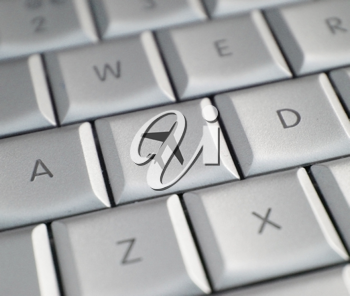 Royalty Free Photo of an Airplane on a Keyboard