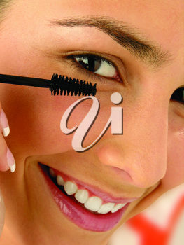 Royalty Free Photo of a Woman Applying Mascara