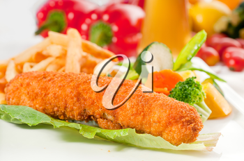 fresh breaded chicken breast roll and vegetables,with lager beer and fresh vegetables on background