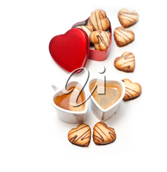 heart shaped cream cookies on red heart metal box and couple of espresso coffee cups
