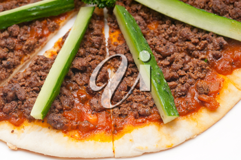 fresh baked Turkish beef pizza with cucumber on top