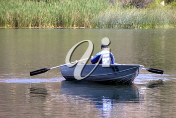 Royalty Free Photo of a Person in a Boat