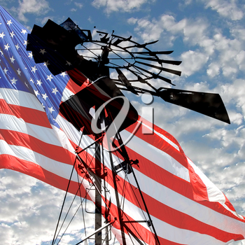 Royalty Free Photo of a Windmill and an American Flag