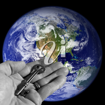 Royalty Free Photo of a Person Holding a Skeleton Key by Earth
