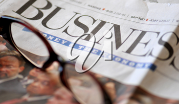 Royalty Free Photo of Glasses on a Newspaper