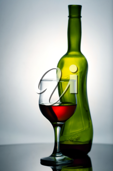 Royalty Free Photo of a Wine Bottle and Glass