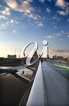 View looking along the length of the Millennium Bridge towards St. Paul�s Cathedral at dusk.