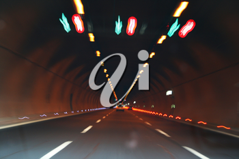 Royalty Free Photo of Lights and Cars in a Tunnel