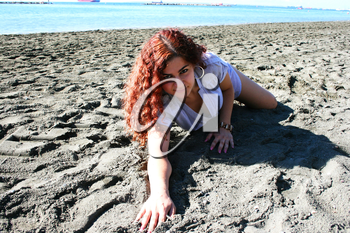 Royalty Free Photo of a Woman on the Beach