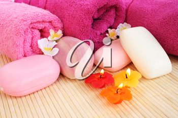 Royalty Free Photo of Soap and Candles by Towels