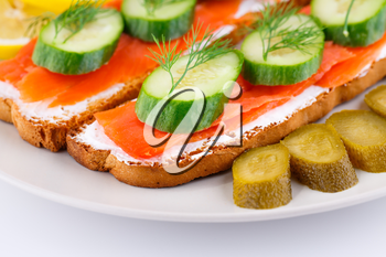 Royalty Free Photo of Smoked Salmon on Bread With Lemons and Pickles