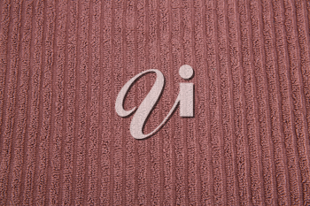 Brown towel texture as a background, closeup picture.