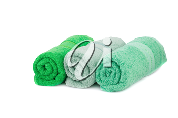 Rolled colorful towels isolated on white background.