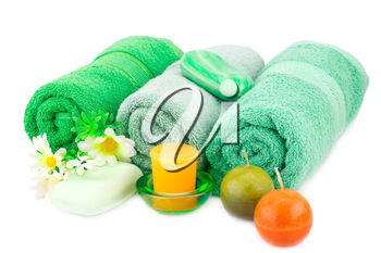 Spa set with towels, candles, soaps and flowers isolated on white background.