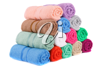 Colorful rolled towels stack isolated on white background.