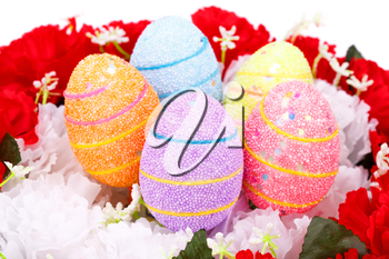 Easter eggs decoration on artificial flowers nest.