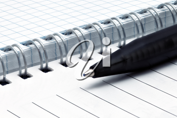 Notebook pages with pen. Isolated over white