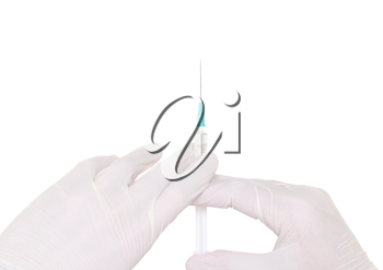 Syringe in a hand in medical gloves, , ready for injection with medication. white background