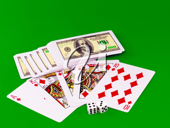 Royal flesh- playing cards on green broadcloth (background).