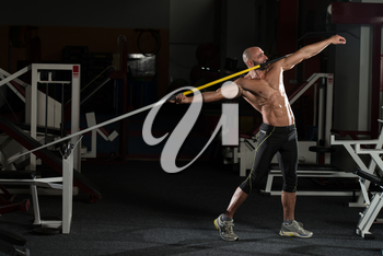 Mature Male Athlete Practicing To Throw A Javelin