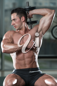 Young Athlete Exercise Triceps - He Is Performing In A Health Club
