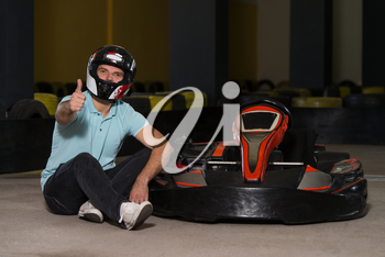 Young Man Showing Thumbs Up For Karting Race