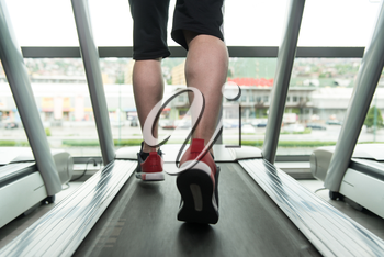 Close Up Of Male Legs Running On Treadmill - Blurred Motion