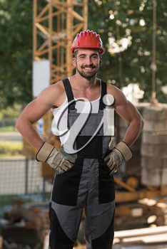 Portrait Of Handsome Male Architect Engineer With Red Helmet