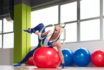 Muscular Woman Stretches On Ball In A Gym And Flexing Muscles - Muscular Athletic Bodybuilder Fitness Model