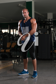 Portrait Of A Physically Fit Man Showing His Well Trained Body - Muscular Athletic Bodybuilder Fitness Model Posing After Exercises
