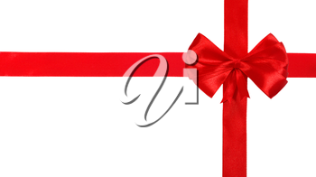 Red satin ribbon with bow isolated over white background